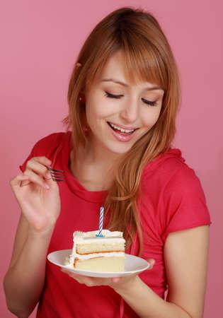 cute girl looking at vanilla birthday cake photo