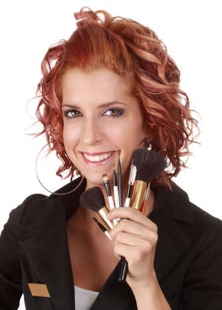 cute beautician holding a makeup brush, isolated on white photo