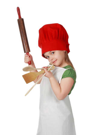 little girl with chief hat holding kitchen ustensil, white background