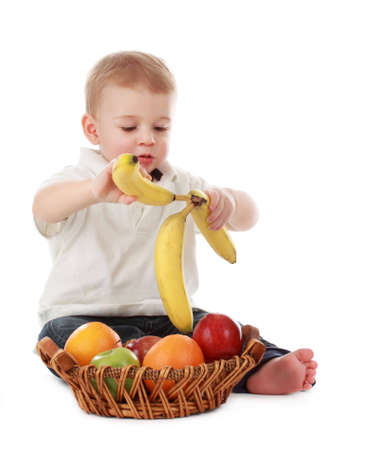 cute one year baby boy with fruit basket, isolated on white