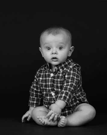 portrait of a cute baby boy, black background Stock Photo - 6680212