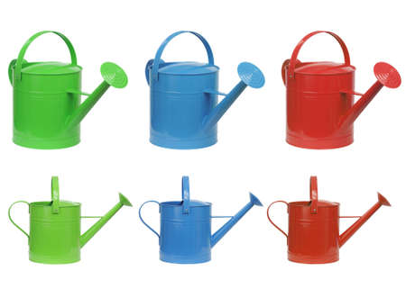 wateringcan: three different color watering can isolated on white