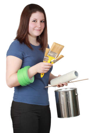 young brunette woman with variety of painting accessories