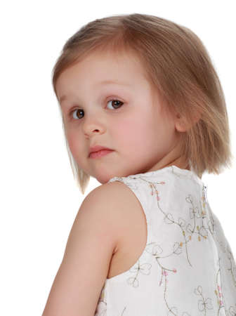 cute little blond girl sitting, isolated on white photo