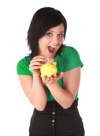 cute young woman holding a little yellow piggy bank