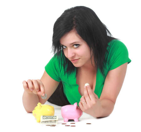 cute young woman with two  little piggy bank Banco de Imagens