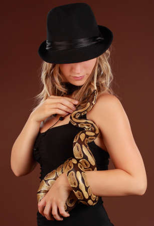 cute blond woman holding a Royal Python snake Stock Photo - 7248547
