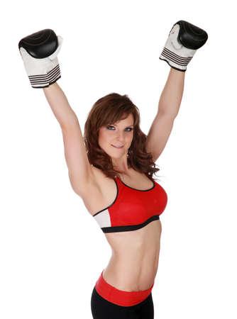 Pretty woman wearing black boxe gloves, white background photo
