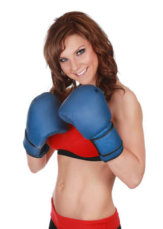 exercice: Pretty woman wearing blue boxe gloves, white background Stock Photo