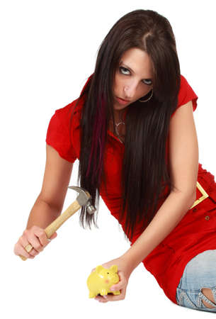 cute young woman with hammer and little piggy bank Banco de Imagens