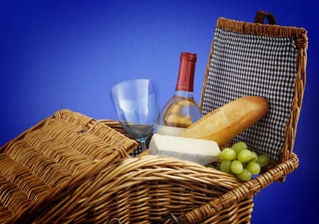 picnic basket with wine, bread and cheese. Stock Photo - 7846813