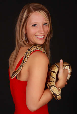 cute blond woman holding a Royal Python snake photo