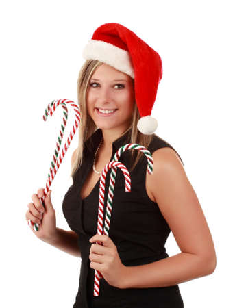 beautiful young blond woman wearing Christmas santa hat and holding fake candy cane, isolated on white background photo