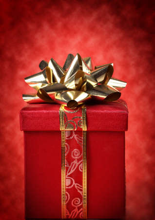 christmas gift: nice red and gold christmas gift, red background Stock Photo