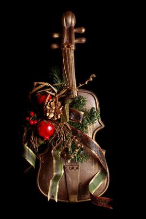 Falso violino come sfondo soprammobile, nero di Natale  Archivio Fotografico - 7987861