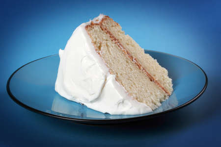 piece of delicious vanilla cake dessert in a blue plate