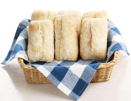 ciabatta bread in a wicker basket with white and blue napkin Zdjęcie Seryjne