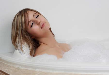 bath: young caucasian woman relaxing in her bath with foam bubble Stock Photo