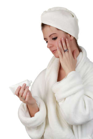 beautiful young woman applying skin care lotion