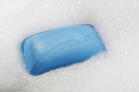 blue soap bar over bubble bath Stock Photo