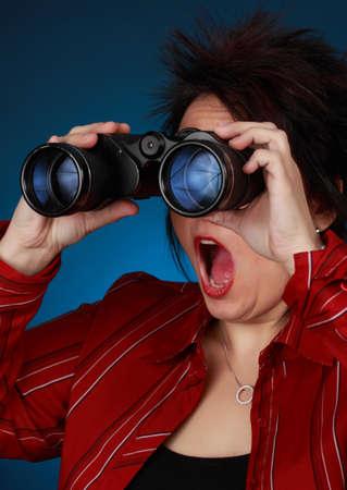 expressive mature woman with binoculars photo