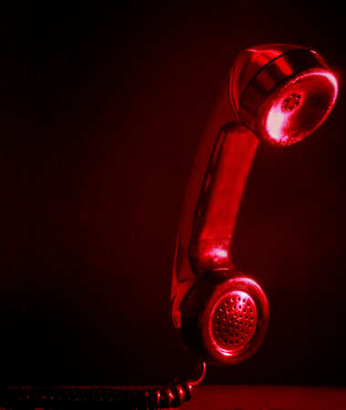 handset: closeup on red phone handset