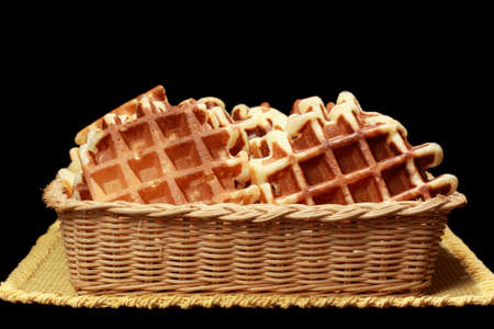 wicker basket filled with fresh homemade waffles Stock Photo - 9179036