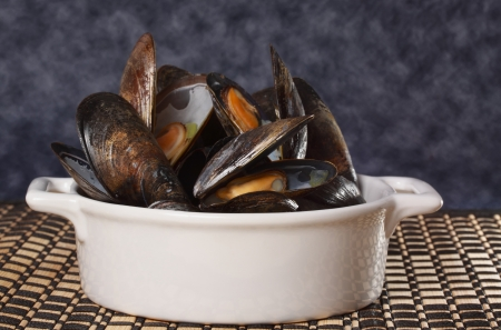 fresh cooked mussels in a white bowl
