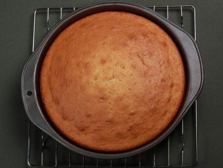 vanilla cooked cake in baking pan
