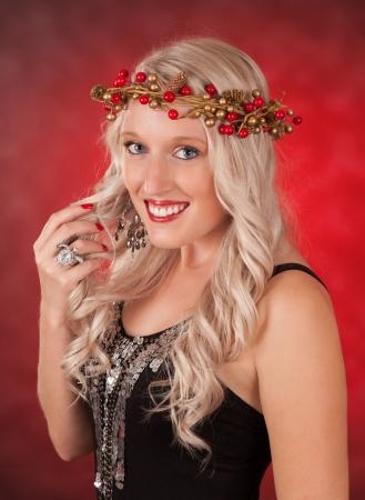 portrait of a beautiful blond caucasian woman wearing xmas conceptual ring crown