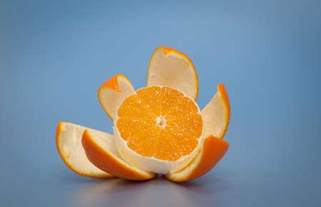 Peeled orange on blue background