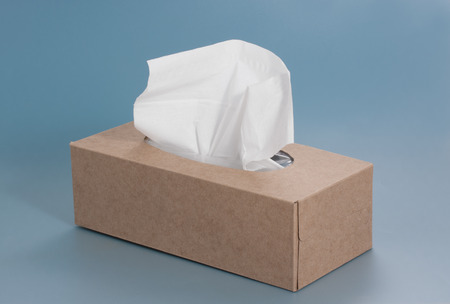 Nice brown tissue paper box on blue background