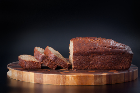 delicious homemade sliced banana bread on a wood plank