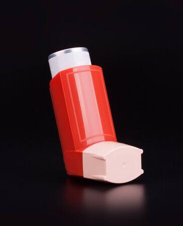 Bronchitis asthma inhaler on black background