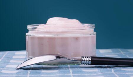 Pink strawberry yogurt in a clear glass bowl