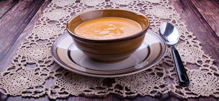Closeup on a carrot cream-soup