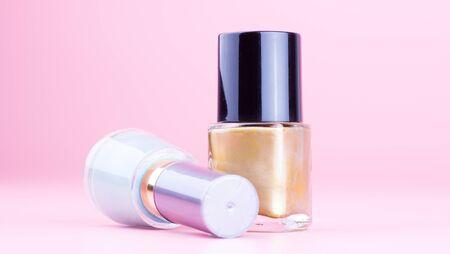Two bottle of nail polish on pink background Reklamní fotografie
