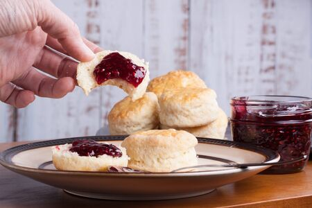 Fresh homemade traditional English scones in a plate ready for the four oclock tea snack