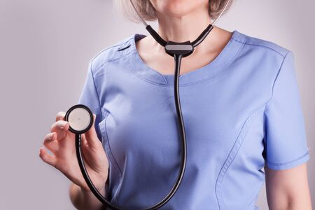 Closeup on a mature nurse with stethoscope Reklamní fotografie
