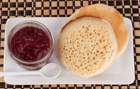 Delicious crumpets and raspberry jam in a reusable glass jar