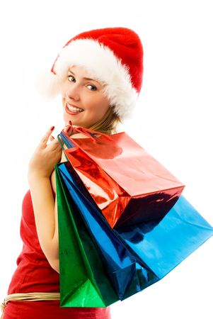 cheerful girl wearing Santa's hat with Chrismas presents Stock Photo - 3771993