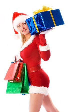 pretty girl dressed as Santa with Christmas presents Stock Photo - 3771992