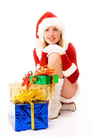 dreamy beautiful girl dressed as Santa with Christmas presents photo
