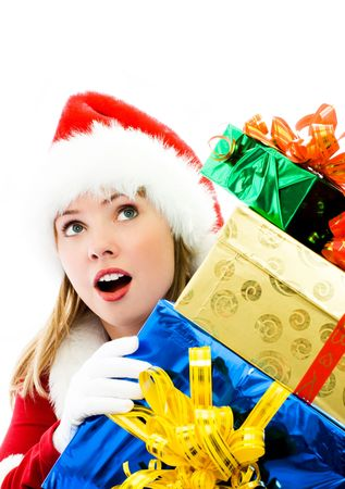 amazement: surprised girl dressed as Santa with a lot of Christmas presents Stock Photo