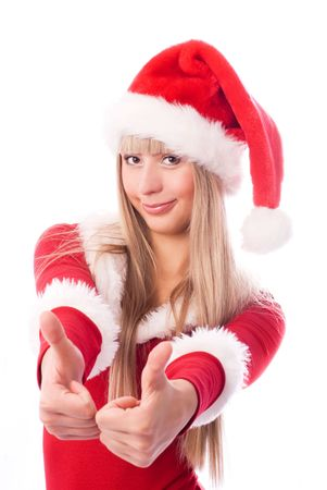 beautiful blond girl dressed as Santa with her thumbs up photo