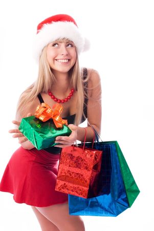 happy girl wearing Santa's hat with Christmas presents Stock Photo - 3783977