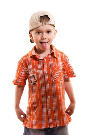 disobedient: little boy making faces and showing his tongue ahainst white background