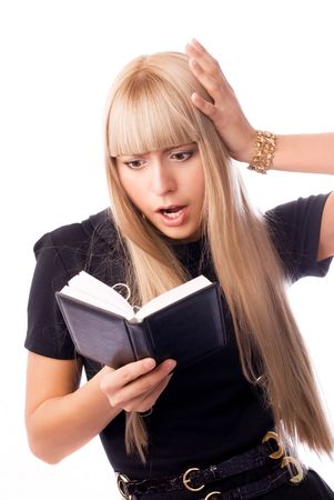 shocked businesswoman looking into her diary photo