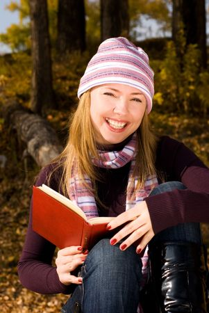 happy girl reading a book photo