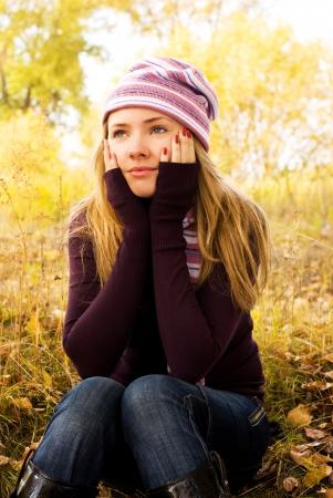sad lonely: pretty sad girl in the park Stock Photo